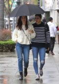 Minka Kelly is all smiles as she steps out in the rain with a friend in Beverly Hills, Los Angeles