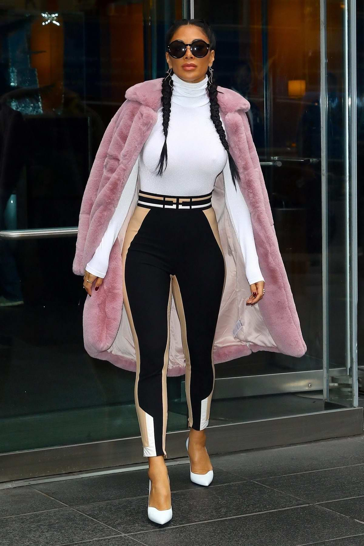 Nicole Scherzinger puts on a stylish display as she stops by the Time Warner Center in New York City