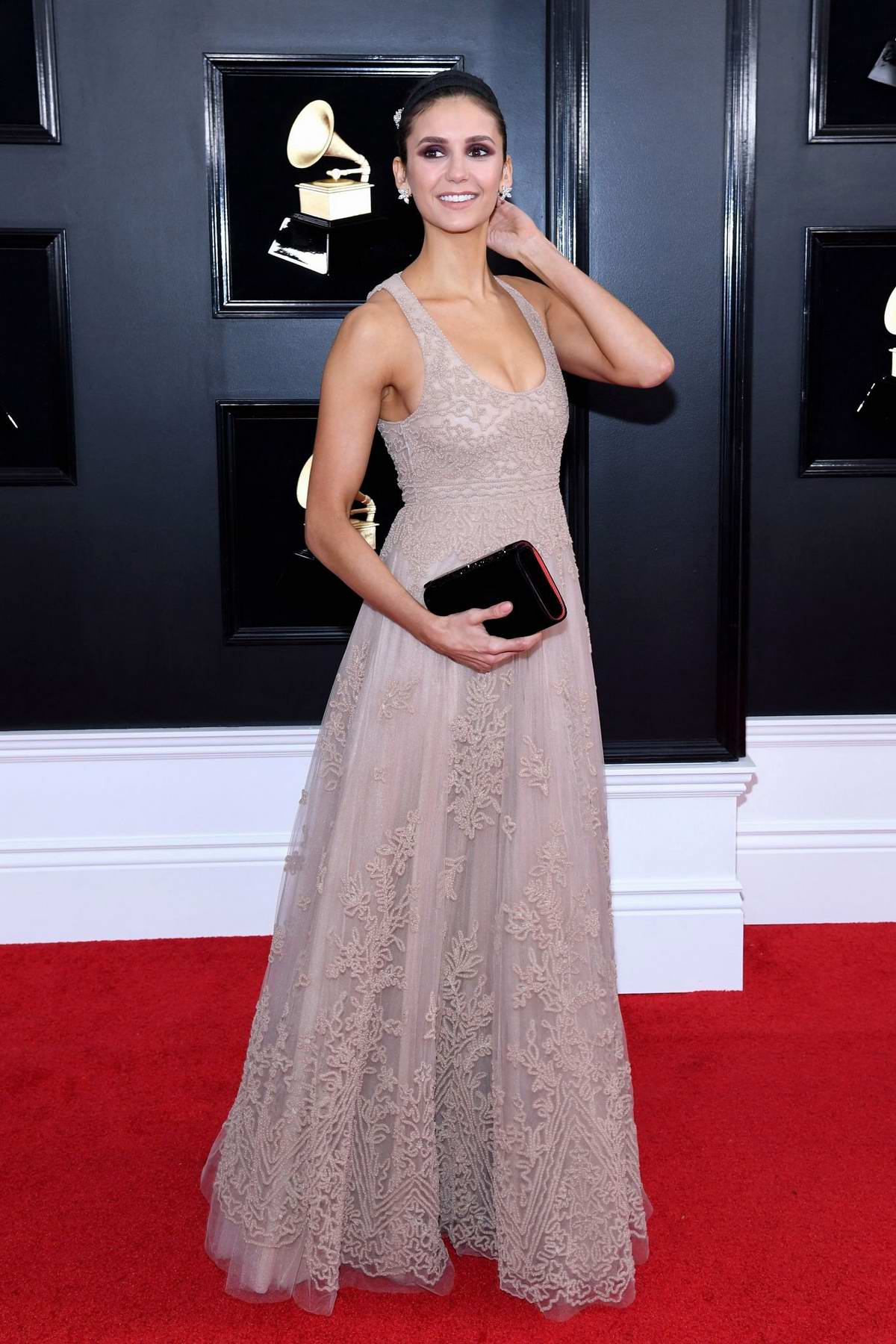 Nina Dobrev attends the 61st Annual GRAMMY Awards (2019 GRAMMYs) at Staples Center in Los Angeles