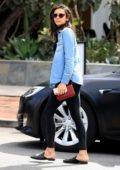 Nina Dobrev dons a denim shirt over a turtle neck sweater with matching leggings and designer loafers while out and about in Los Angeles