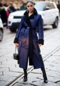 Olivia Culpo looks stylish in a blue coat from Blumarine while out during Milan Fashion Week in Milan, Italy