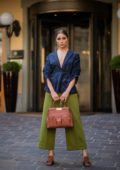 Olivia Culpo shows off her chic style in a blue blazer and rolled-up lime-green pants while attending Milan Fashion Week in Milan, Italy