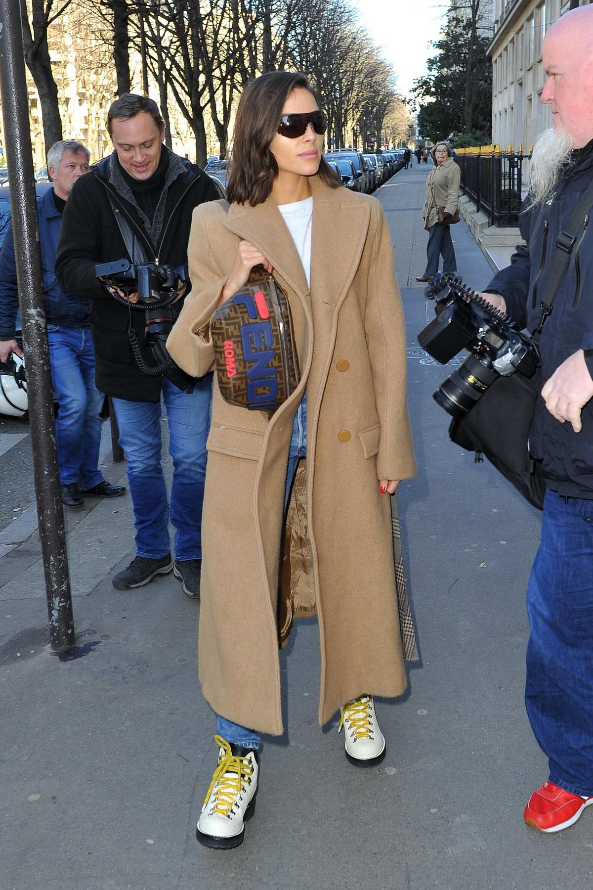 Olivia Culpo spotted in a brown long coat while leaving l'Avenue restaurant in Paris, France