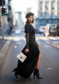 Olivia Culpo stuns in a black dress with a beret during Milan Fashion Week in Milan, Italy