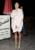 Olivia Jade Giannulli waits for her car outside of Delilah nightclub in West Hollywood, Los Angeles