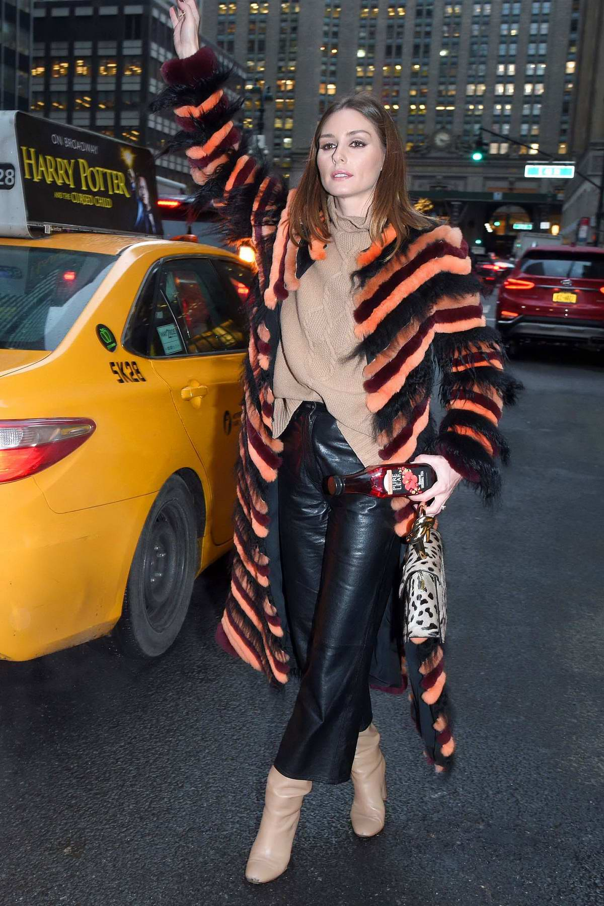 olivia palermo look chic in an orange and black fur coat ...