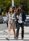 Paris Jackson rocks a tunic top, denim shorts and Golden Goose sneakers while out shopping with Gabriel Glenn in Los Angeles