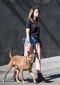 Paris Jackson steps out in a tee and denim shorts to walk her dog in in Los Angeles