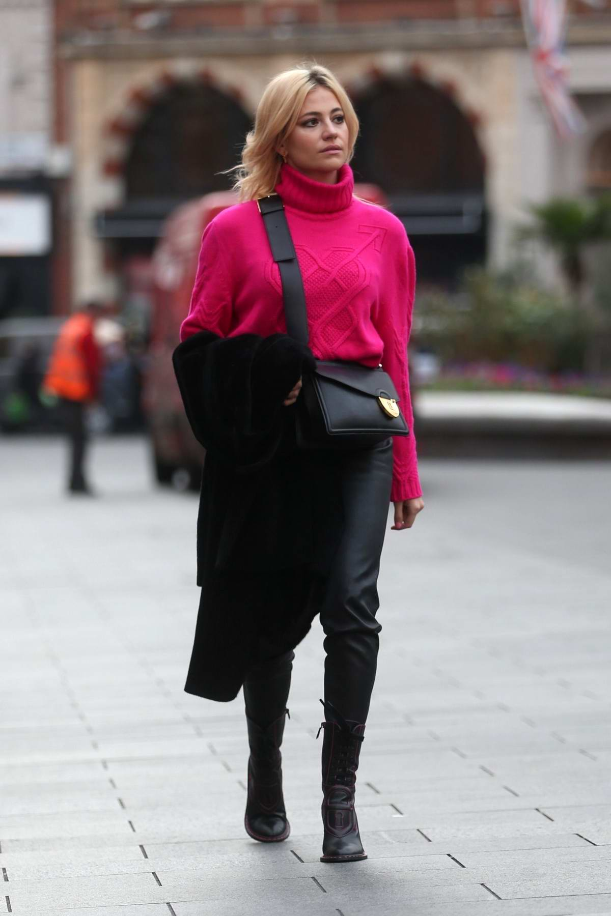 Pixie Lott looks pretty in pink as she arrives with Mabel to Global Radio studios in London, UK