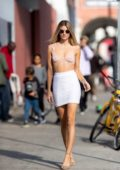 Rachel McCord poses in a soft pink sheer bra top and white skirt during a photoshoot in Los Angeles