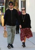 Reese Witherspoon and husband Jim Toth hold hands as they leave after lunch in Brentwood, Los Angeles