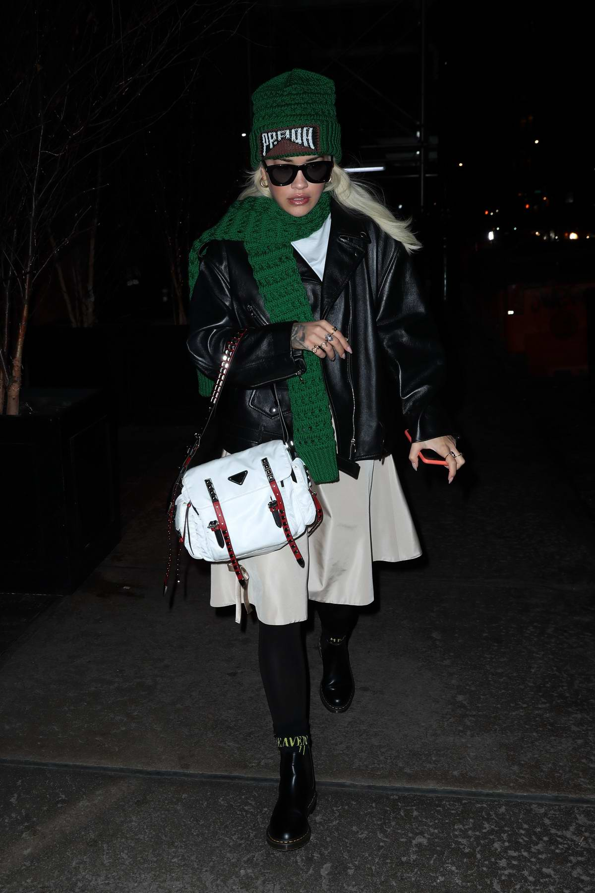 Rita Ora bundles up in a black leather jacket with knitted green scarf and hat while out in New York City