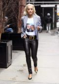 Rita Ora looks trendy in a checkered blazer and black leather pants while out during New York Fashion Week in New York City
