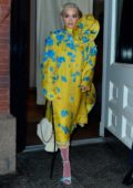 Rita Ora stands out in a yellow and blue dress and pink stockings as she leaves the Mercer Hotel in New York City