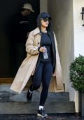 Rita Ora wore a rain coat with black hoodie and leggings as leaves after a workout session in Beverly Hills, Los Angeles