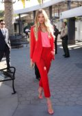 Romee Strijd looks stunning in a bright red suit while visiting 'Extra' at Universal Studios in Universal City, California