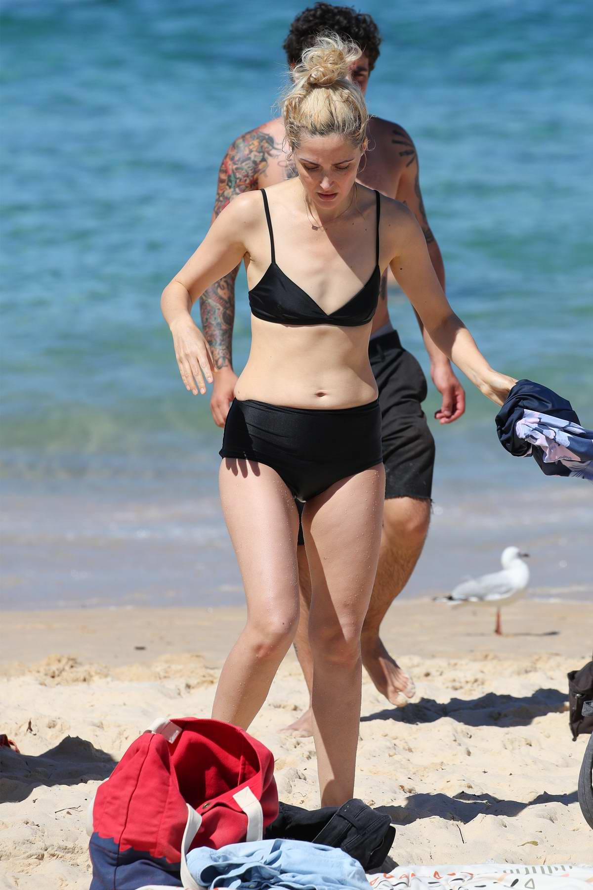 Rose Byrne seen wearing a black bikini during a beach day with husband Bobby Cannavale at Bondi Beach in Sydney, Australia