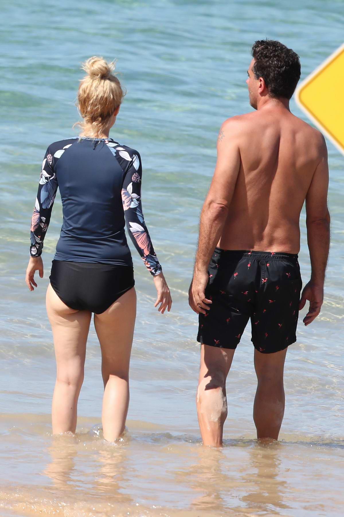 rose byrne seen wearing a black bikini during a beach day