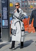Rosie Huntington Whiteley wears a stylish Celine coat with black knee high boots while out in New York City