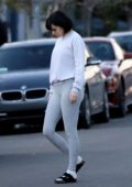 Rumer Willis sports a white sweatshirt and grey leggings while heading for a workout in her Tesla in Los Angeles