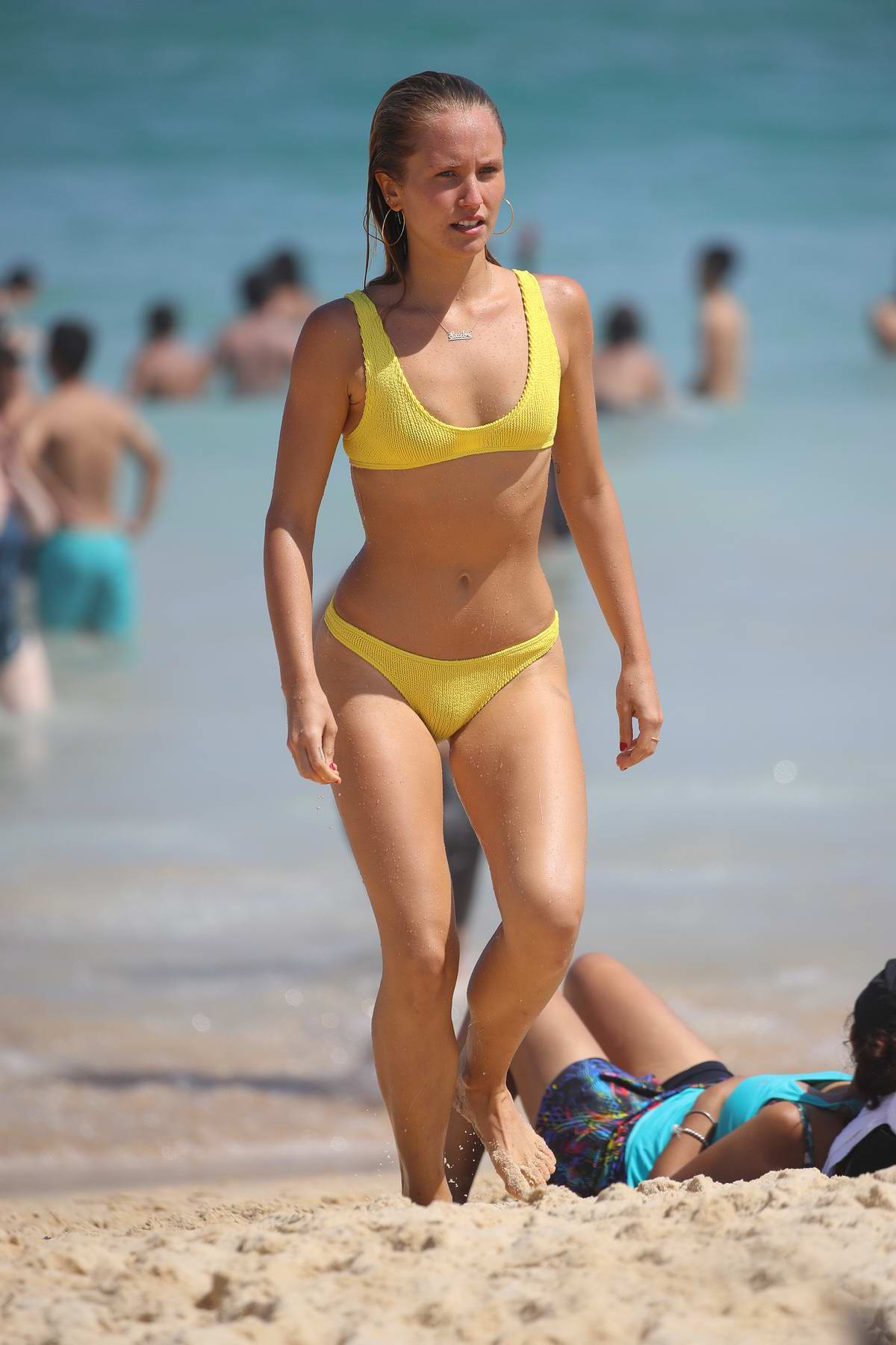 Sailor Brinkley Cook wears a yellow bikini as she takes a dip in the ocean on Australia Day in Bondi, Sydney, Australia