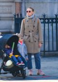 Scarlett Johansson wore a grey tweed jacket, blue pants and Nike trainers while out on a stroll in New York City