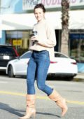 Shantel VanSanten waves at the camera while out on a coffee run in Los Angeles