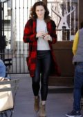 Shantel VanSanten wears a red and black plaid jacket with black leather pants while out for coffee at Alfred's in Los Angeles