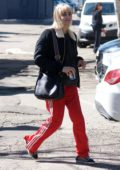 Sofia Boutella steps out in bright red Adidas track pants while running errands in West Hollywood, Los Angeles
