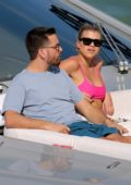 Sofia Richie wears a hot pink bikini top while relaxing on a yacht with Scott Disick in Miami, Florida
