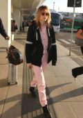 Suki Waterhouse wears pink stripes as she touches down in Milan, Italy