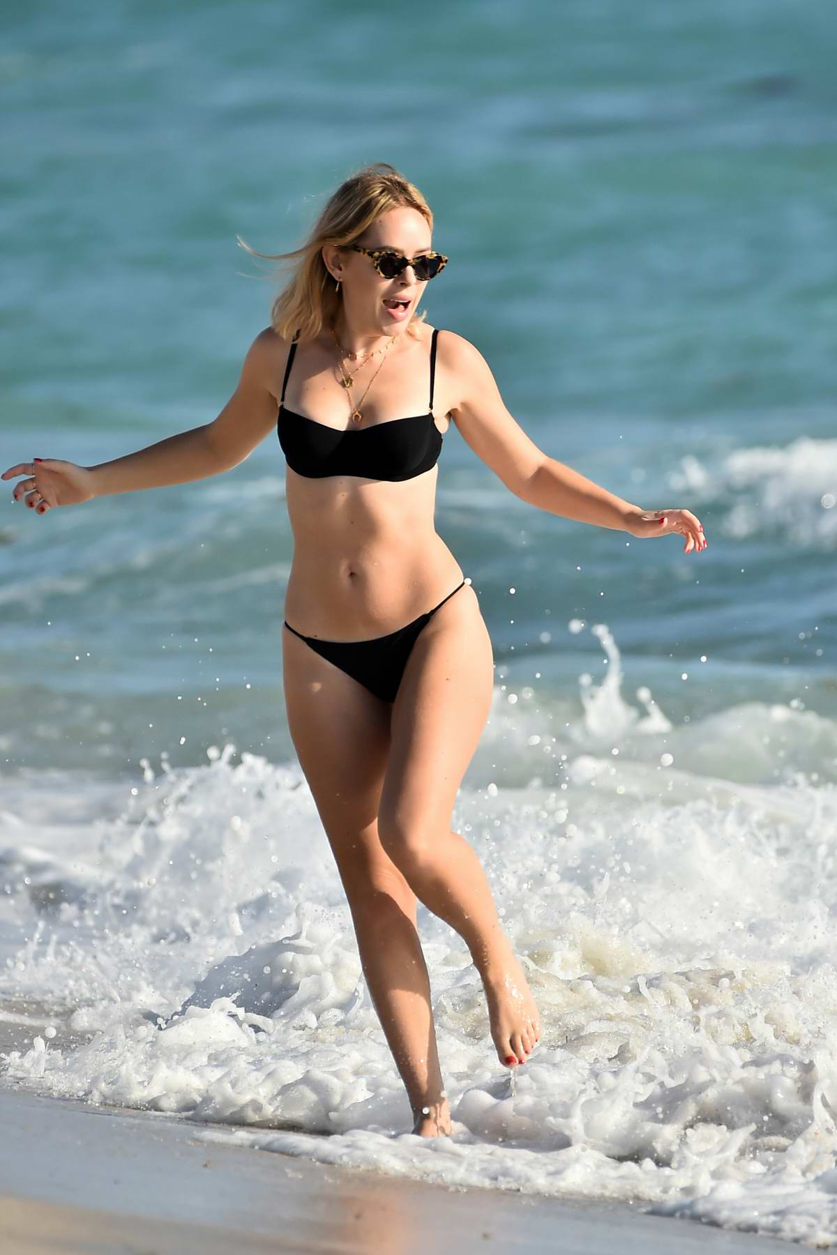 Tanya Burr hits the beach in a black bikini during her vacation in Miami, Florida