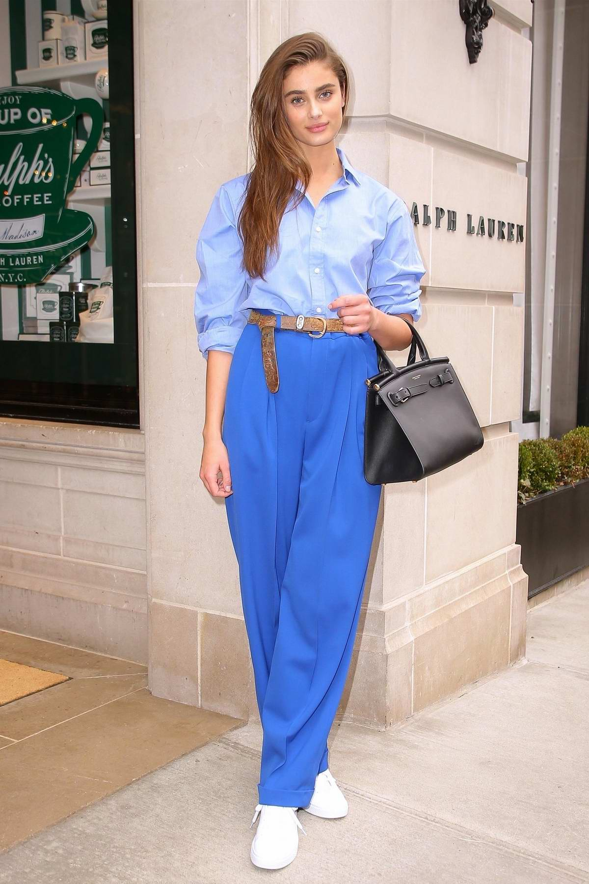 Taylor Hill leaves the Ralph Lauren Fashion Show during New York Fashion Week in New York City