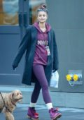 Taylor Hill spotted in a purple hoodie with matching leggings and boots while out for a stroll in New York City