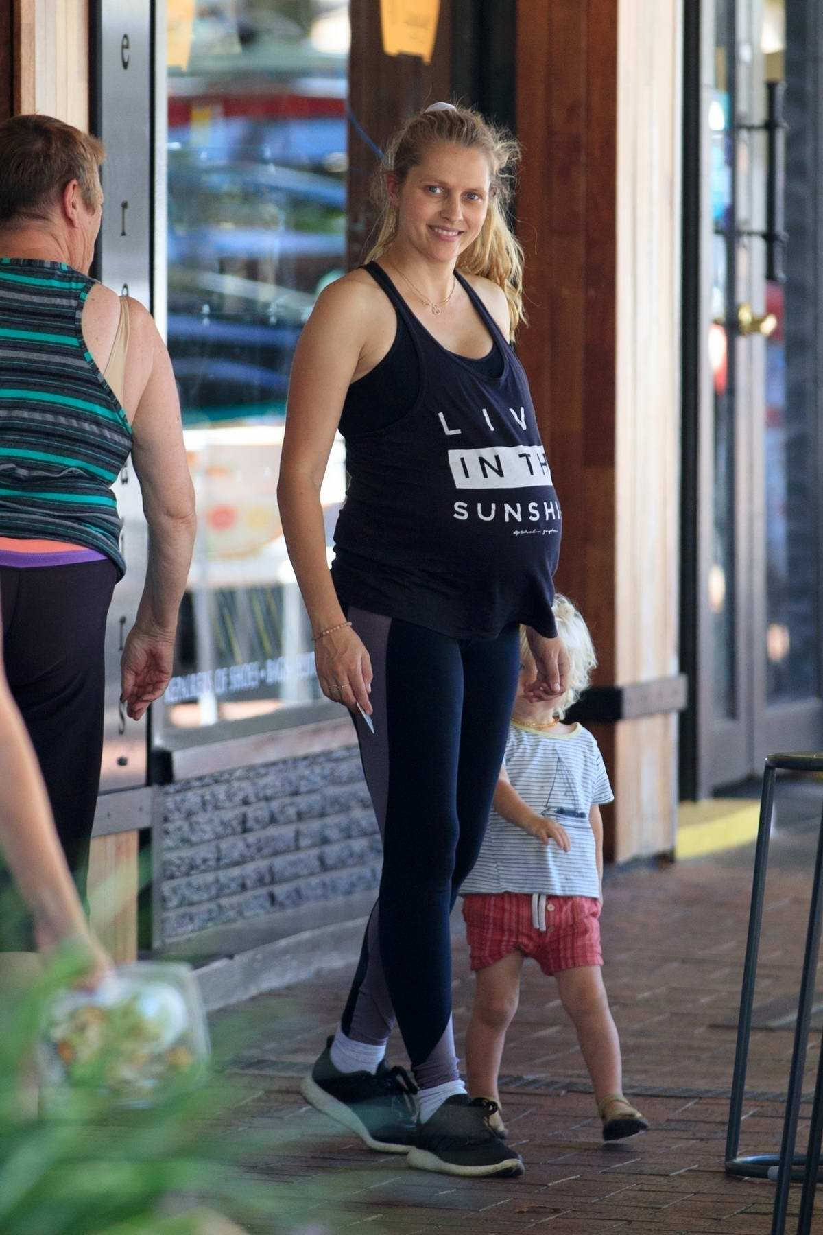 Teresa Palmer shows off her baby bump in a black tank top and leggings while out for some shopping in Adelaide, Australia