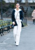 Victoria Justice looks stylish in a cropped white hoodie, white pants and black pinstriped blazer while out for a stroll in Central Park, New York City