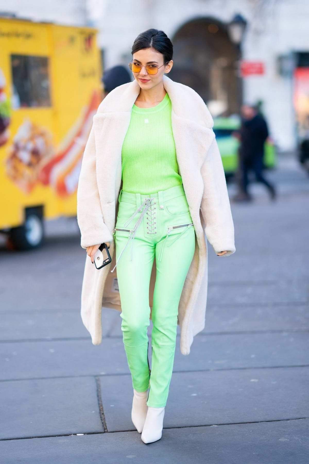 Victoria Justice seen wearing a lime green top with matching pants while out and about in New York City