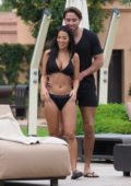 Yazmin Oukhellou rocks a black Calvin Klein bikini as enjoys a day with James Lock while on holiday in Morocco