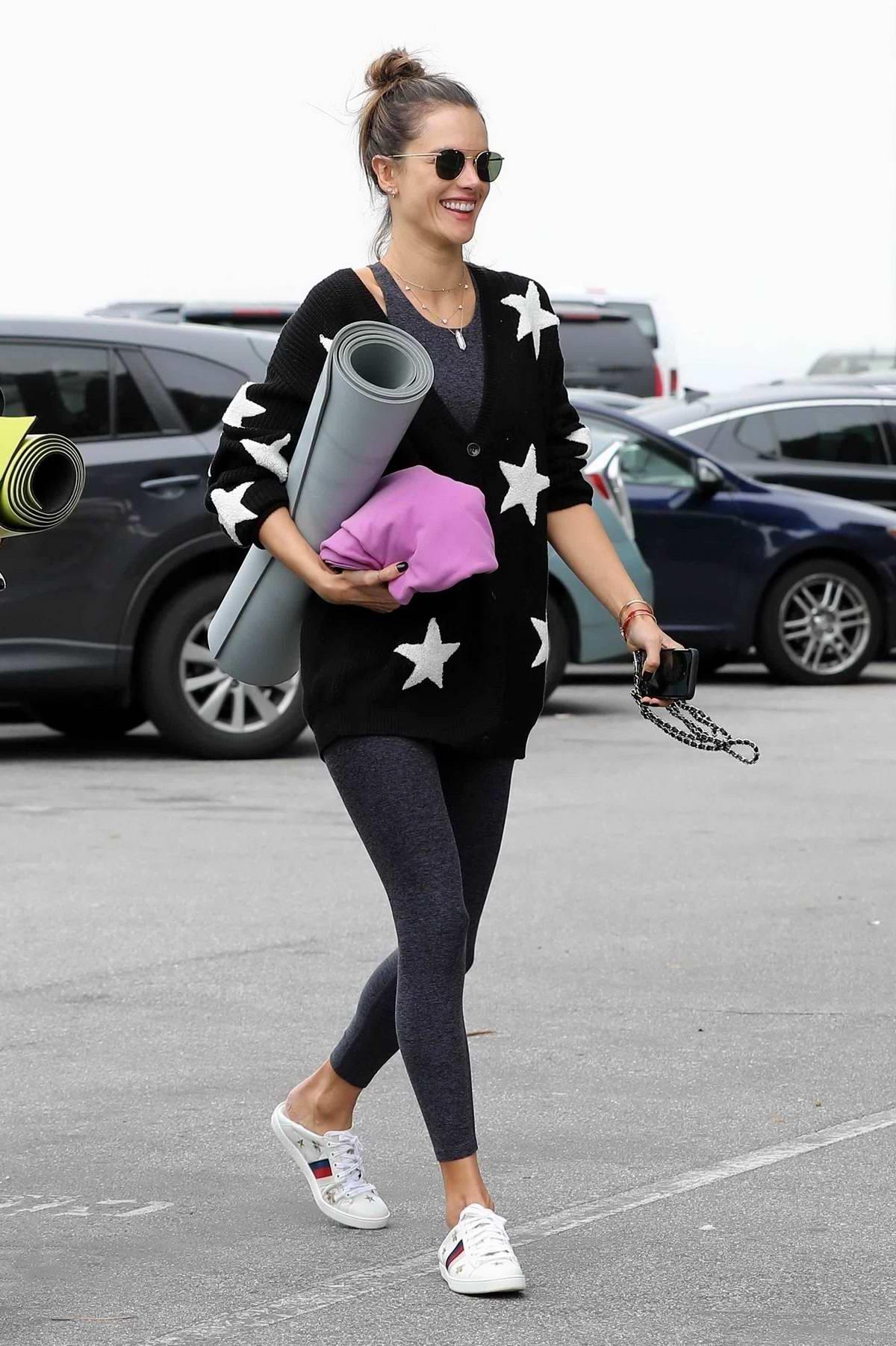 Alessandra Ambrosio is all smiles as she heads to a yoga studio with Nicolo Oddi in Venice Beach, California