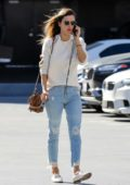 Alessandra Ambrosio looks stunning in a cream sweater, ripped jeans and a Fendi bag as she heads to a business meeting in Los Angeles