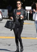 Alessandra Ambrosio rocks a black leather jacket, a black top and leggings during a coffee run in Brentwood, Los Angeles
