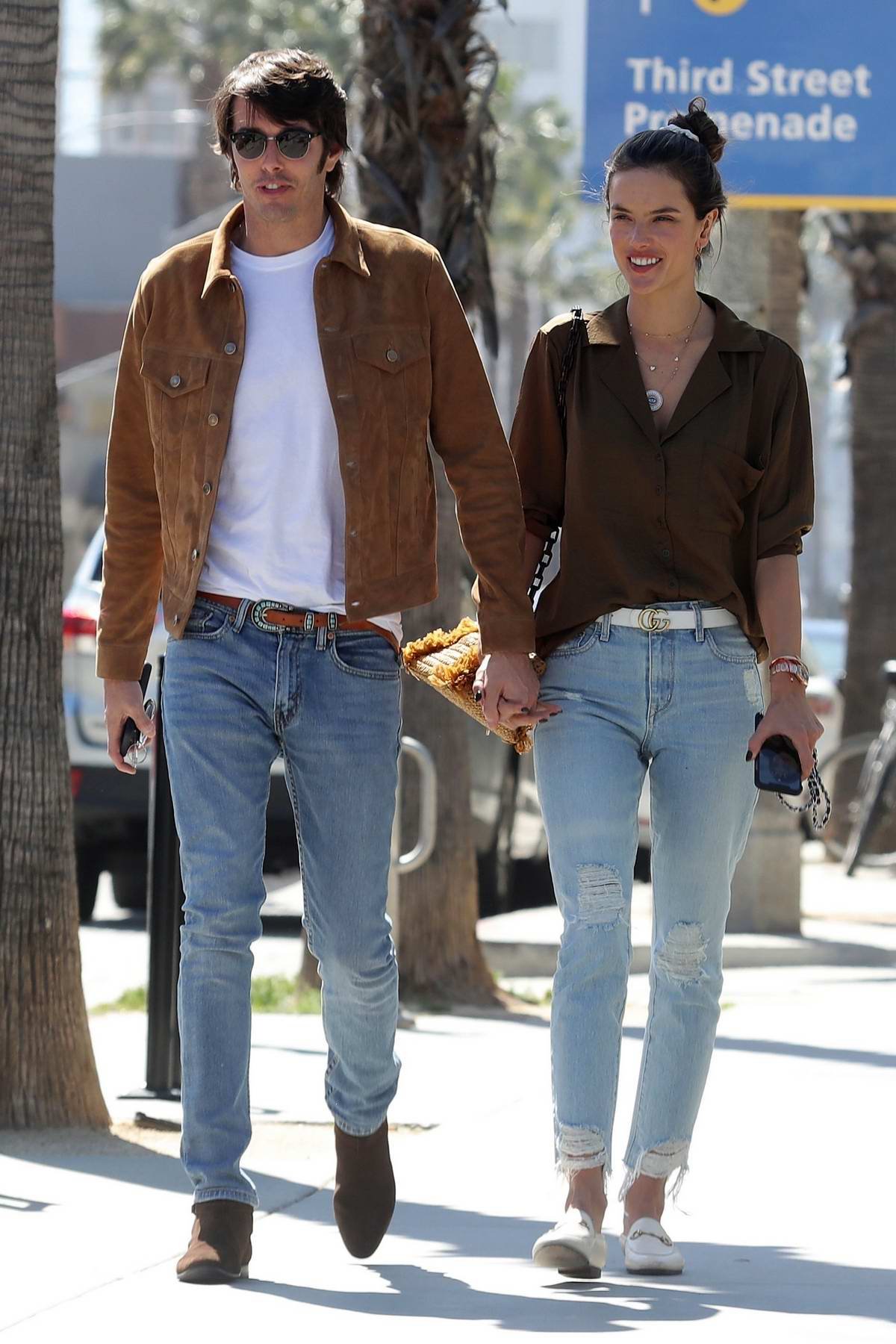 Alessandra Ambrosio rocks a brown silk shirt and ripped jeans while out for lunch with Nicolo Oddi in Los Angeles