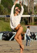 Alessandra Ambrosio shows off her amazing body in a black bikini during a game of beach volleyball in Los Angeles