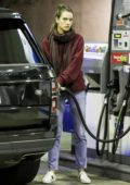 Alessandra Ambrosio stops by a gas station to fill the tank of her Range Rover in Brentwood, Los Angeles