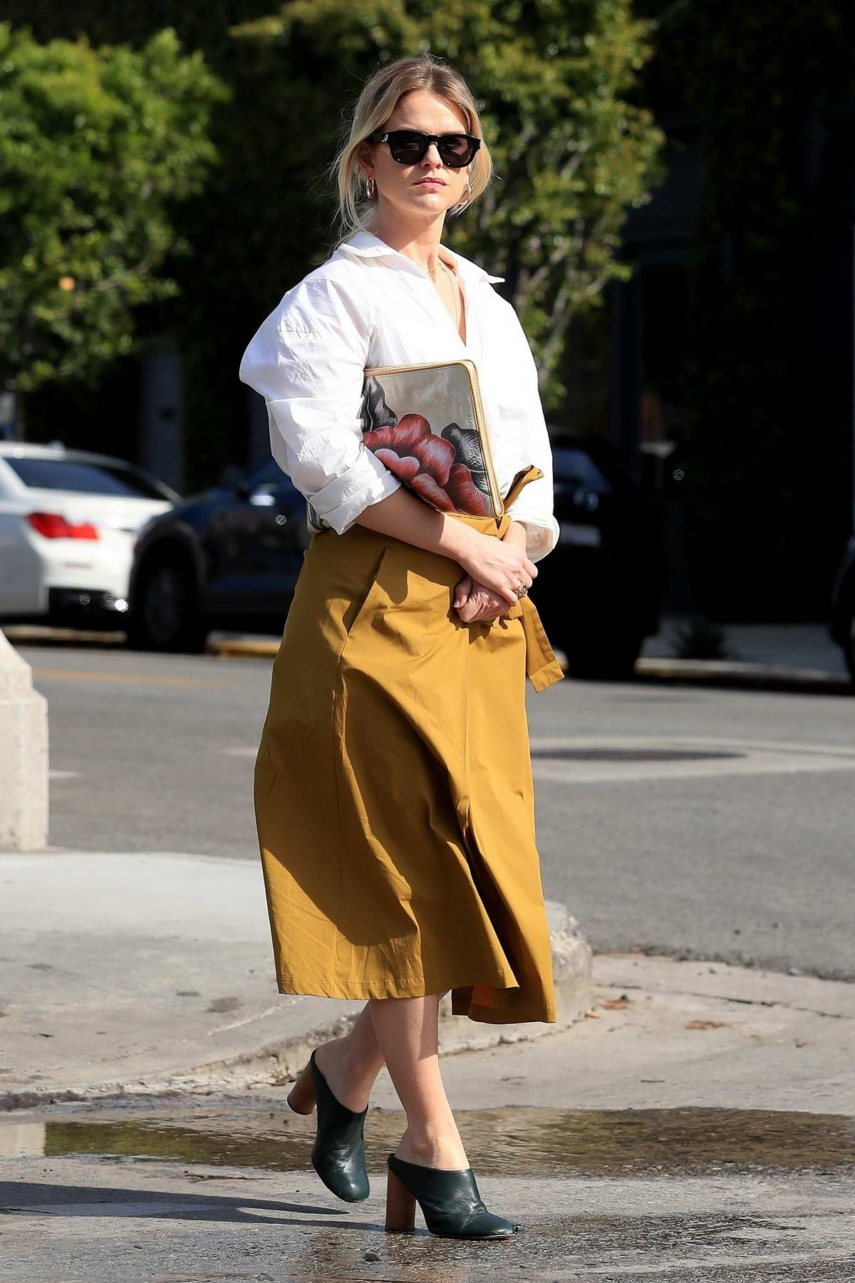 Alice Eve looks fashionably chic in a white shirt and mustard yellow skirt as she steps out for a meeting in West Hollywood, Los Angeles