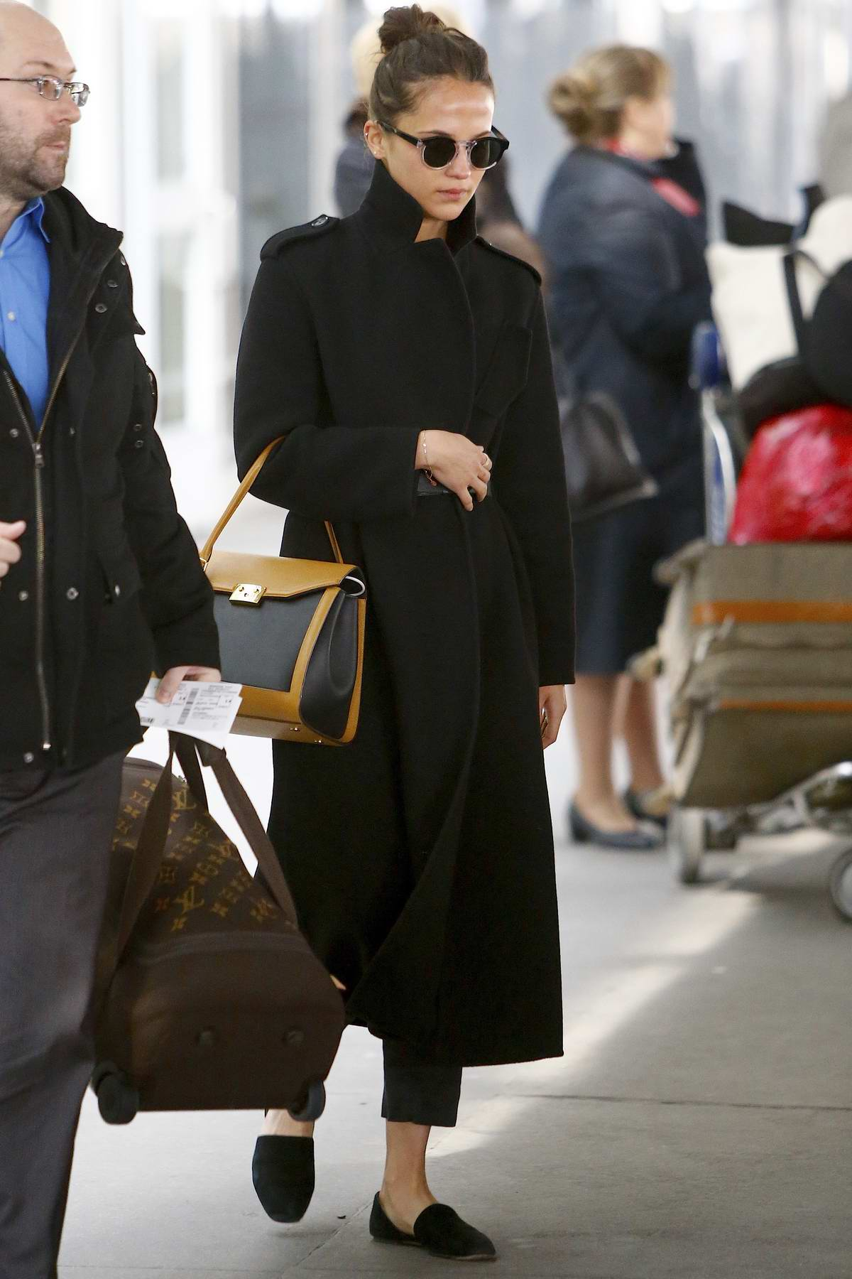 Alicia Vikander dressed in all black as she arrives at JFK airport in New York City