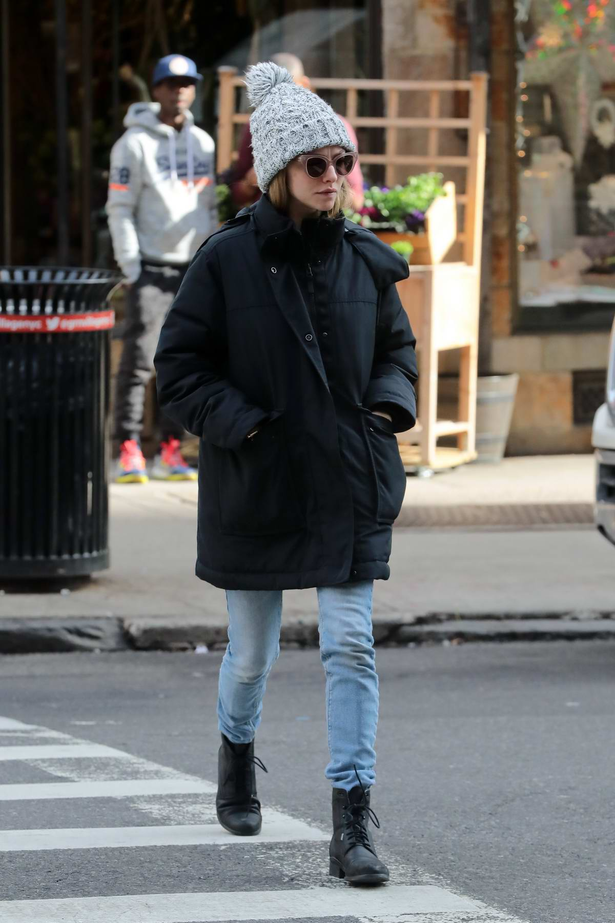 Amanda Seyfried keeps warm in a knit beanie and a black jacket while out in New York City