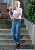 Amber Heard cradled her friend's baby while visiting her friend in Los Angeles