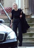 Amber Heard dons an all black ensemble as she leaves a business meeting in Los Angeles