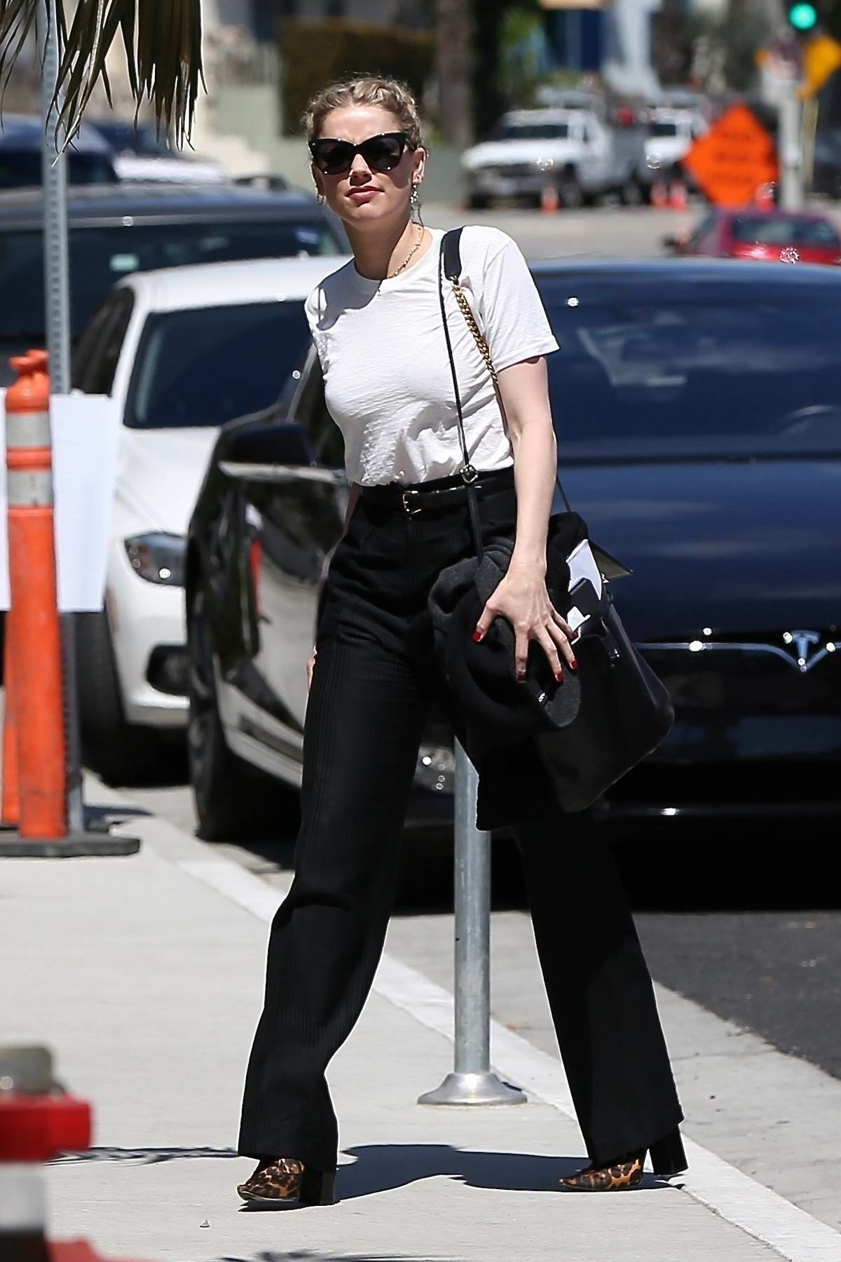 Amber Heard dressed for business as she heads to a meeting at San Vicente Bungalow in West Hollywood, Los Angeles